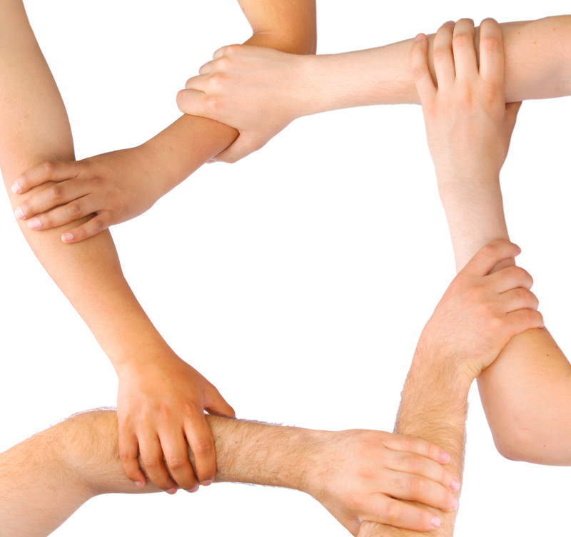 business people linking hands